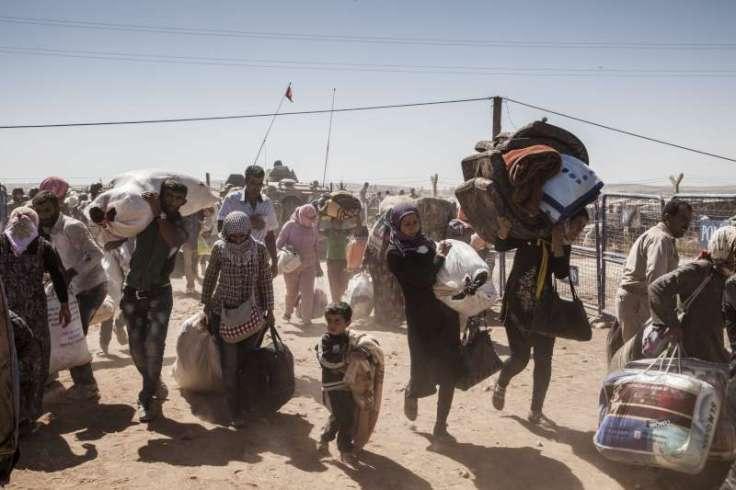 Syrian refugees entering Turkey, UNHCR/I.Prickett