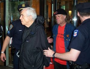 Pacifist Fr. Daniel Berrigan being arrested, Wikipedia