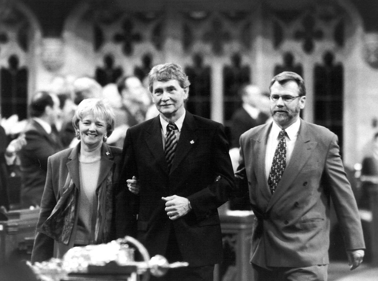 NDP leader Alexa McDonough and MP Richard Proctor escort Dennis Gruending into the House of Commons, 1999